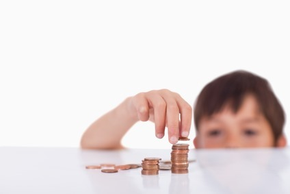 Young boy counting his change