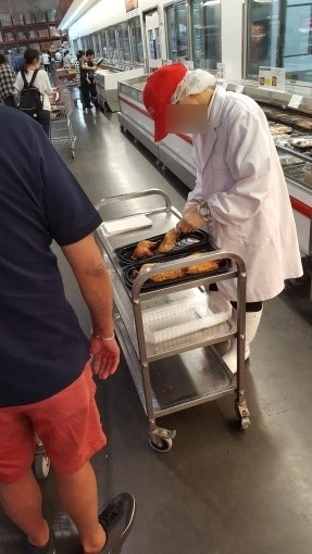 costco_serves_chicken_leg_for_service_10_sh