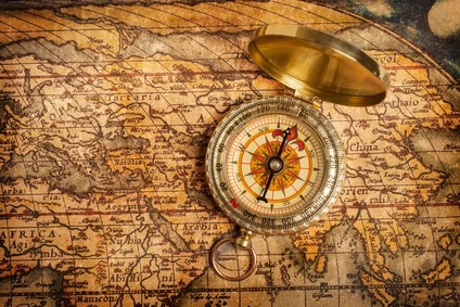 old-vintage-golden-compass-on-ancient-map_sizeXS