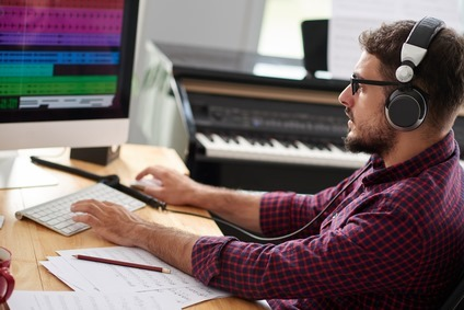 Composer listening to new song